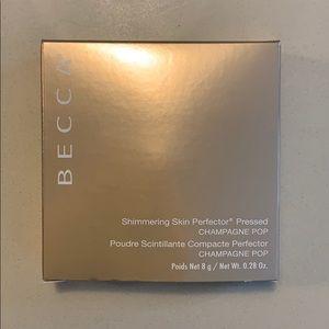 BECCA Pressed Highlighter